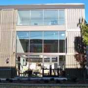Three-Story Shipping Container Building with Windows
